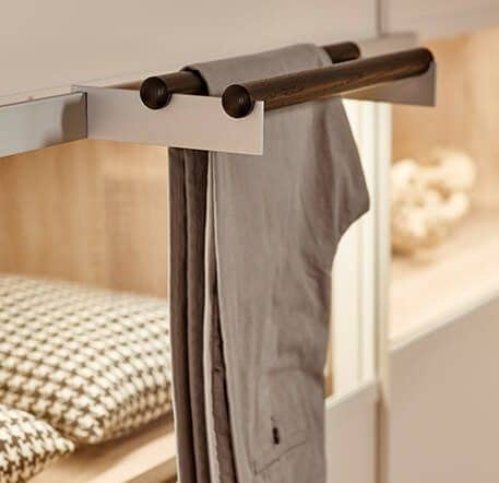 The picture depicts a wardrobe by Ars Nova Collection on which a t-shirt is hanging on a hanger.