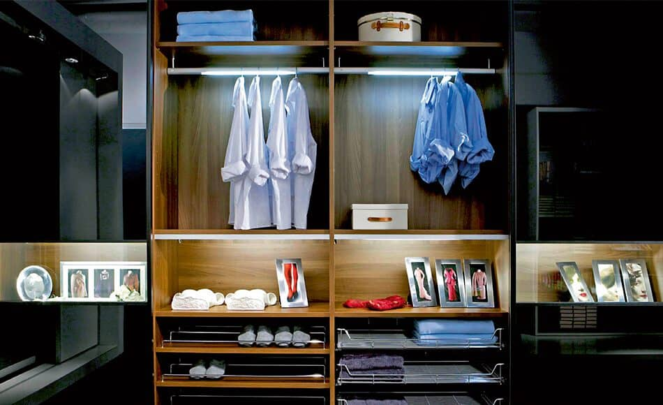 This is an example of the Beta-Quattro-wardrobe in mid-brown wood. The illuminated interior ensures that you have a clear view of all your clothing.