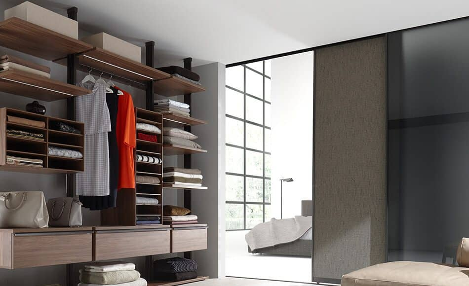 walk-in and illuminated wardrobe with a lot of storage space