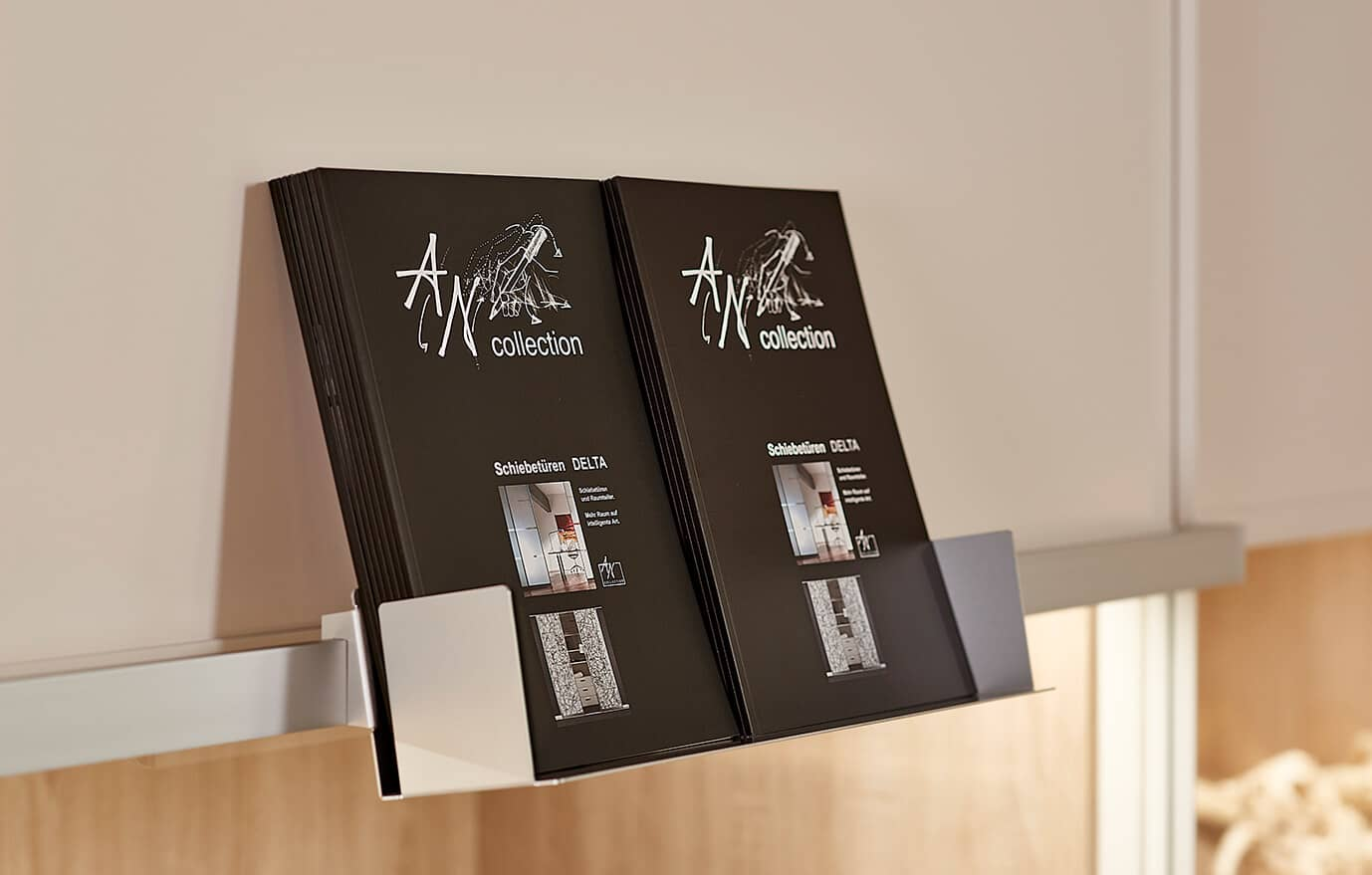 The picture the depicts Ars Nova Collection catalog on a holder.